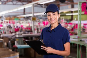 beautiful female clothing factory worker with clipboard